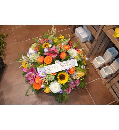 Coussin rond de fleurs pour un deuil